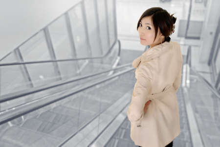 Attractive young woman of Asian inside of modern building. photo