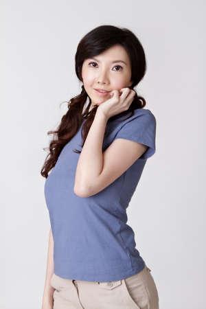 Attractive Asian woman, closeup portrait in studio gray background. Stock Photo - 8911423