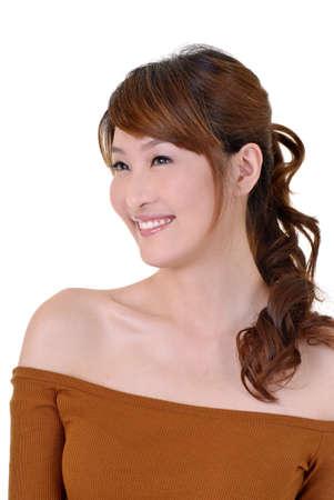 Smiling woman of Asian, closeup portrait on white background. Stock Photo - 8965859
