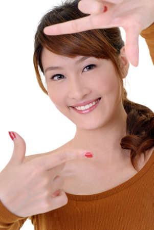 facial gestures: Asian beauty make frame by hands with happy smiling face. Stock Photo