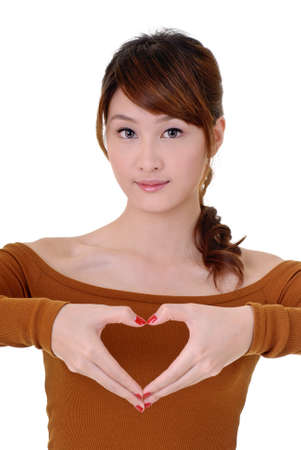 Heart shape make by Asian attractive beauty, closeup portrait on white background.