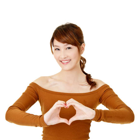 Happy woman make heart shape by her hands, closeup portrait on white background. photo