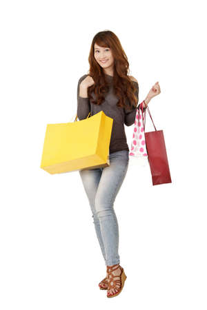 shopping centre: Happy shopping woman of Asian holding bags, isolated on white background.