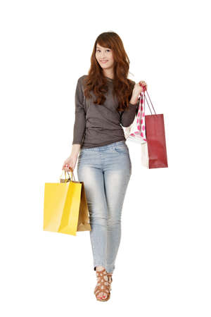 eastern asian: Happy shopping woman of Asian holding bags, isolated on white background.
