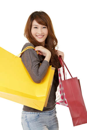 Happy smiling shopping girl, closeup portrait on white background. photo