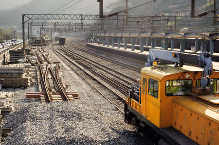 Train station with cars and railroad in small town of Taiwan, Asia. Stock Photo - 8966146