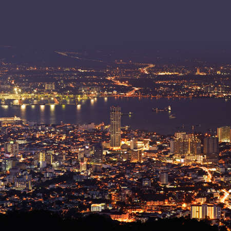 City night scene of harbor and tower in Penang, Malaysia, Asia. photo