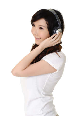 Young woman listen music with headphone, closeup portrait on white. photo