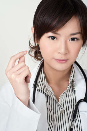 Young Asian doctor, closeup portrait of woman. Stock Photo - 9041907