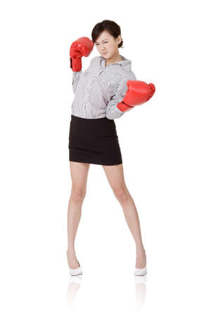 Business woman fight with boxing gloves, isolated on white background. photo
