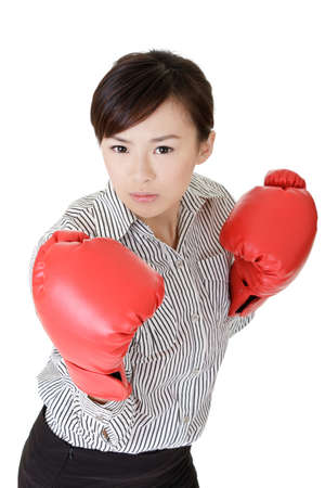 Young business woman fighting, closeup portrait on white background. photo