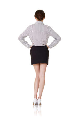 Full length portrait of young business woman of Asian, rear view, isolated on white. photo