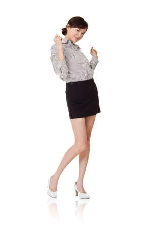 excitation: Excited young business woman, full length portrait on white.
