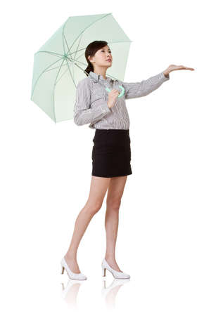 woman with umbrella: Business woman holding umbrella of green, isolated on white background.