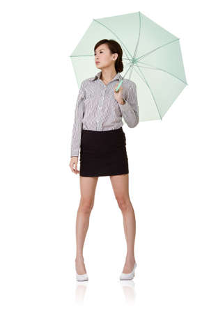 Business woman holding umbrella of green, isolated on white background. photo
