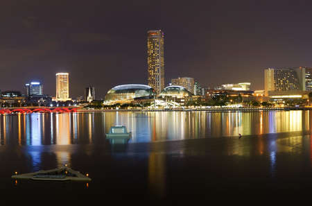 Cityscape of night with skyscrapers and river in Singapore, Asia. photo