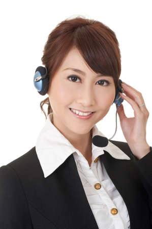 online service: Attractive Asian business secretary with smiling face, closeup portrait. Stock Photo