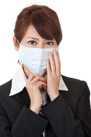 Business woman in protective mask, closeup portrait on white background. photo