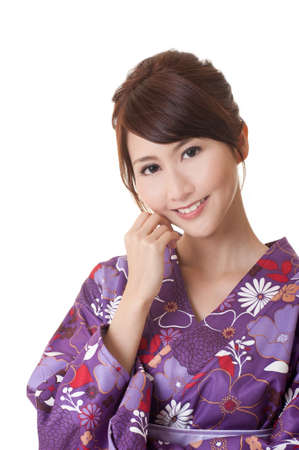 japanese kimono: Attractive young Japaneses woman in traditional clothes looking at you, against on white background. Stock Photo