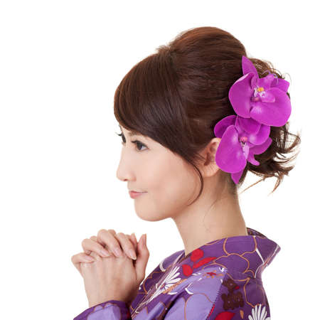 traditional events: Japaneses woman praying, young Asian beauty dress in yukata. Stock Photo