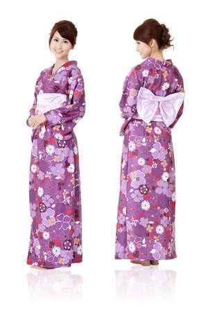 kimono: Mujer japonesa en ropas tradicionales de Kimono con vista frontal y posterior, retrato de longitud completa aislada sobre fondo blanco. Foto de archivo