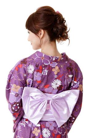 yukata: Japanese elegant woman in traditional clothes, kimono, closeup portrait of back view. Stock Photo
