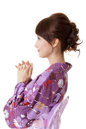 Japanese woman praying, closeup portrait of Asian lady in traditional clothes, kimono. Stock Photo - 9113905