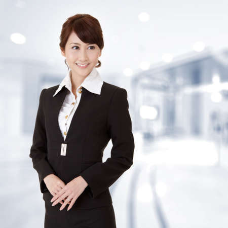 Successful young executive woman smiling, closeup portrait in office. photo