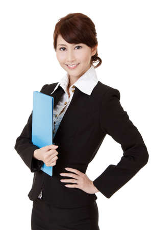 half  length: Smiling young executive woman of Asian holding file document, half length closeup portrait on white background.