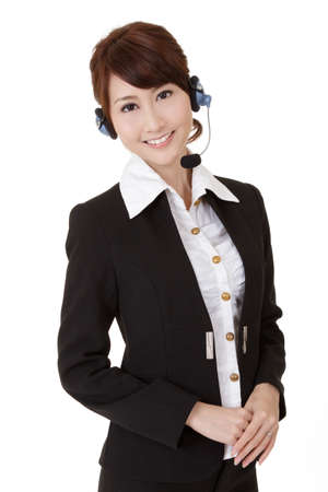 helpful: Asian secretary woman with headphone smiling and looking at you, half length closeup portrait on white background.