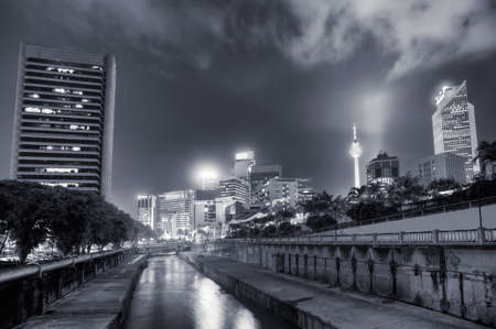Night view with modern buildings and river in Kuala Lumpur, Malaysia, Asia. photo