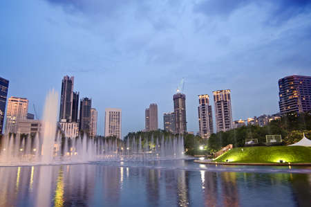Colorful city night with buildings and fountain in Kuala Lumpur, Malaysia, Asia. photo
