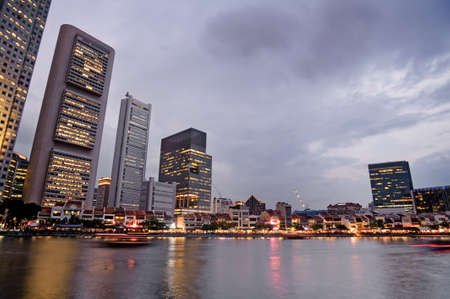 Skyscrapers in the colorful sunset harbor in Singapore, asia. photo