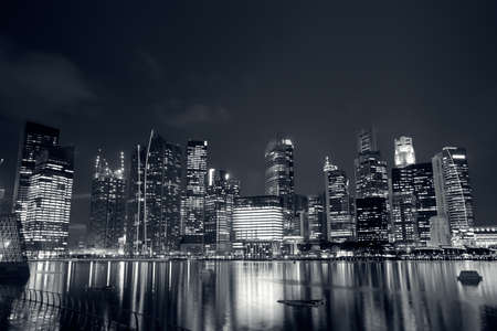 Modern city skyline with reflection on river in Singapore, Asia. photo