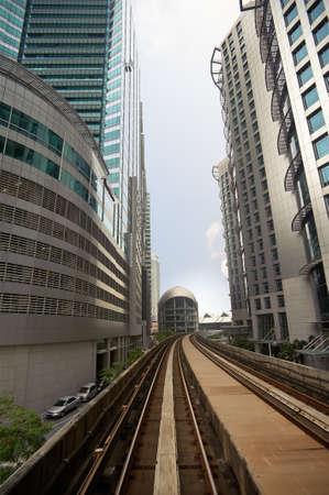 City scenery with railroad over business skyscraper. photo