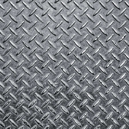 Background of metal diamond plate in silver color. photo
