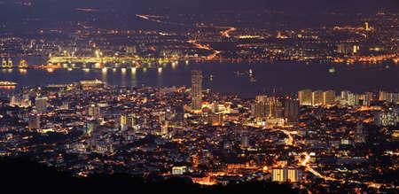 penang: Panoramic cityscape in night with river and tower in Penang, Malaysia, Asia. Stock Photo