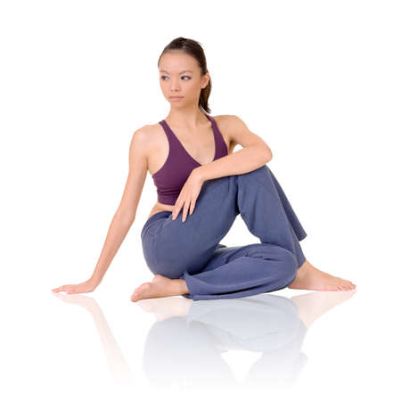 Yoga exercise on ground by Asian girl of fitness, full length portrait isolated on white background. photo