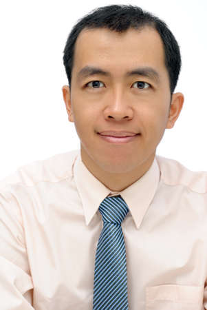 Friendly mature business man of Asian looking at you, half length closeup portrait on white background.