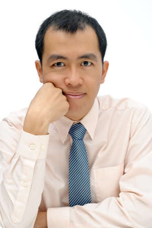 thinking of you: Mature executive of Asian considering and thinking and looking at you, half length closeup portrait on white background.