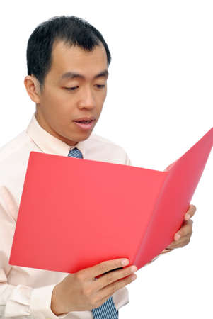 Surprised business man reading paper in red folder of document, half length closeup portrait on white background. photo