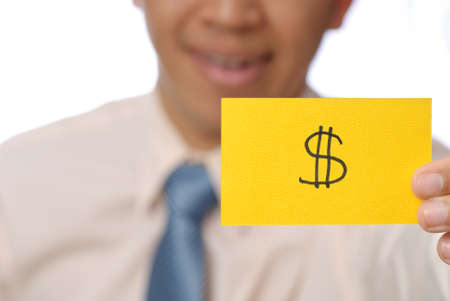 Money shape on yellow card holding by business man, closeup image. photo