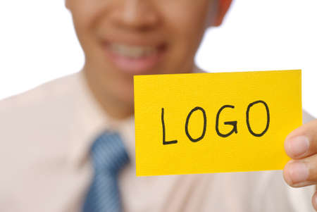 Logo words on yellow card holding by business man, closeup image. photo