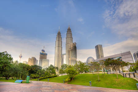 Colorful cityscape of famous skyscrapers with green park under blue sky in Kuala Lumpur, Malaysia, Asia. Stock Photo - 9244540