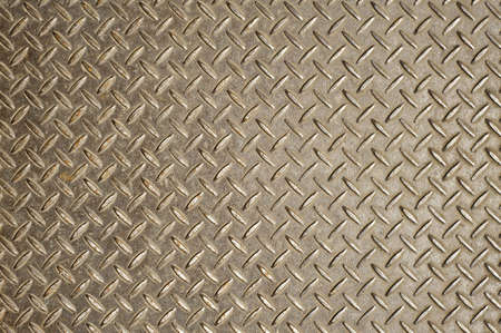 Background of old and grungy metal diamond plate with light. Stock Photo - 9244541