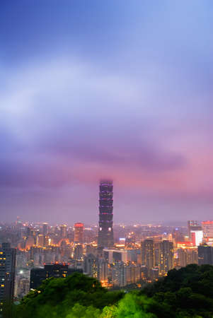 Dramatic landscape of clouds in modern city with skyscraper in night in Taipei, Taiwan. Stock Photo - 9244508