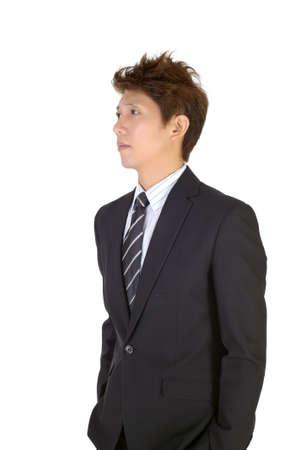 uneasiness: Preocupada joven guapo Ejecutivo, closeup retrato sobre fondo blanco.