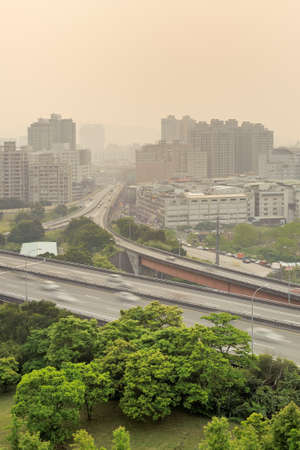 taiwan scenery: City scenery of sunset with buildings and high way under mist because air pollution in Taipei, Taiwan, Asia.