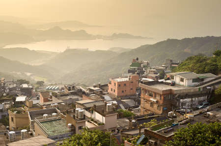 taiwan scenery: City sunset scenery with buildings on hill and harbor far away in Jiufen(Jioufen), Taiwan, Asia.