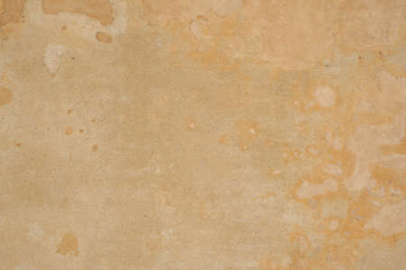 Background of wall with dirty spot in yellow color. photo